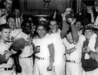 Brooklyn Dodgers win their first World Championship by shutting out the New York Yankees, 2-0