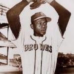 Satchel Paige signs a contract to play for the Birmingham Barons of the Negro National League
