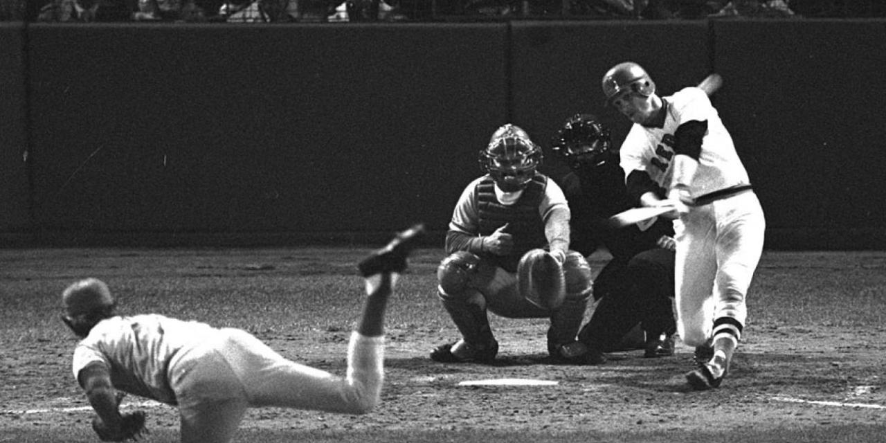 Carlton Fisk of the Boston Red Sox powers a dramatic 12th- inning home run to complete one of the most memorable games in World Series history.
