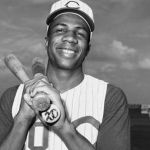 Frank Robinson of the Cincinnati Reds hits three home runs in an 11-4 win over the St. Louis Cardinals