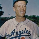 Maury Wills homers from both sides of the plate