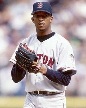 Pedro Martinez of the Boston Red Sox becomes the first pitcher to win the American League Cy Young Award unanimously in consecutive years