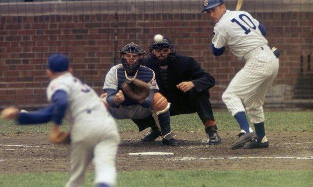 Ron Santo is struck by a pitch halting his consecutive game streak – but not the hitting streak