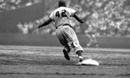 Dodger second baseman Jackie Robinson becomes the first black player to win the MVP Award