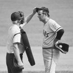 Gaylord Perry of the Seattle Mariners is caught putting a foreign substance on the ball