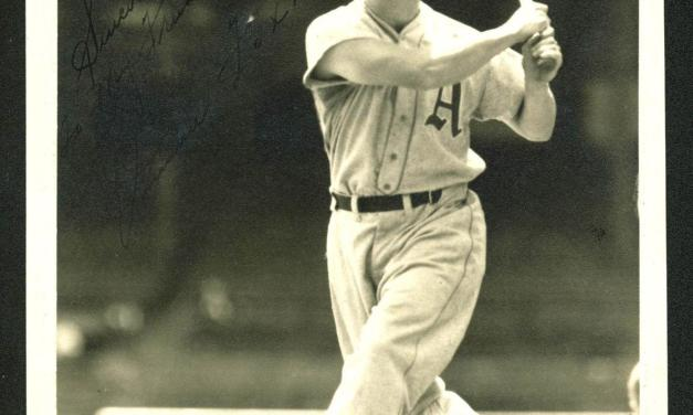 Slugger Jimmie Foxx signs with the National League's Philadelphia Phillies.