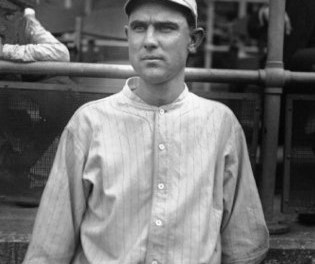 Boston rookie Ernie Shore stops the Naps in Cleveland, 4 – 1.