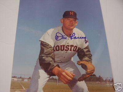 Don Larsen tosses a five-hitter in the Texas heat to best Warren Spahn It is Larsen's first complete game in five years.