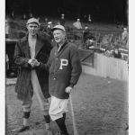 The Philadelphia Phillies win their first-ever World Series game behind Grover Cleveland Alexander, 3 - 1