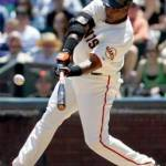 Giants OF Barry Bonds hits his 26th homer, the 400th of his career, off Kirt Ojala of the Marlins in the Giants' 10 - 5 victory. He thus becomes the first player in major league history with more than 400 career home runs and 400 career steals.