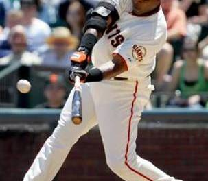 For the second time in the season, Barry Bonds hits three home runs in a game and passes Maris for most homeruns in a season for a left handed batter
