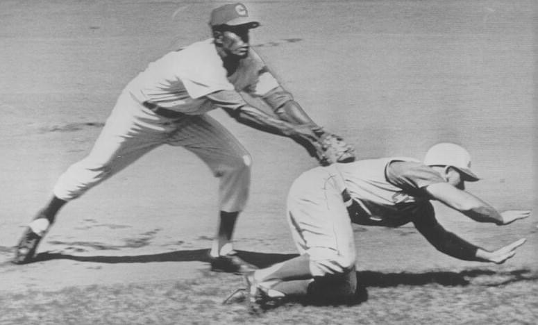 1962 Reds Don Zimmer gets caught in a rundown, and is tagged out by Cubs SS Andre Rodgers as he dives back to second.