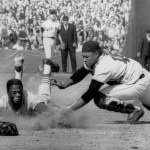 Lou Brock slides head first in to home to beat the tag by  Red Sox catcher Elston Howard in Game 6 of the 1967 World Series