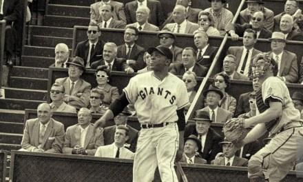 Willie Mays watches his 31st homerun