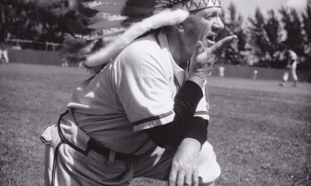Charlie Grimm, who forgot to pack his baseball cap and had to wear a head dress