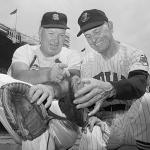 Dizzy Dean (L) points out to Earl Averill, toe that liner off the bat of Averill broke during 1937 All-Star game