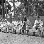 Jackie Robinson finds himself a seat on Montreal's bench as he joins the Royals for the first time in an exhibition game against their major league affiliate, the Brooklyn Dodgers.
