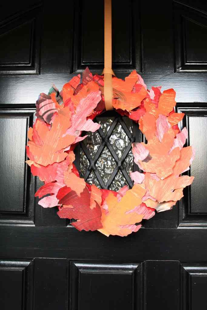 Fall wreath on door. DIY wreath of paper leaves.