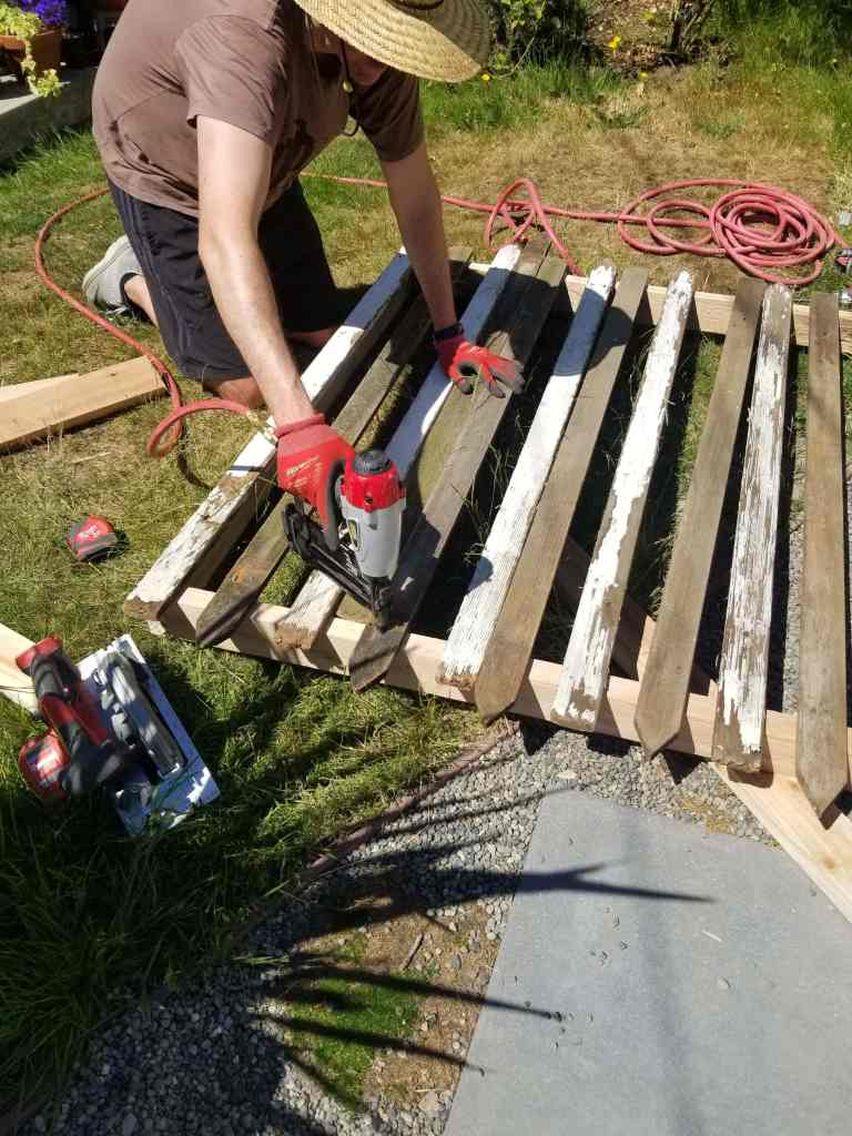 Building a DIY privacy screen from salvaged fence posts.