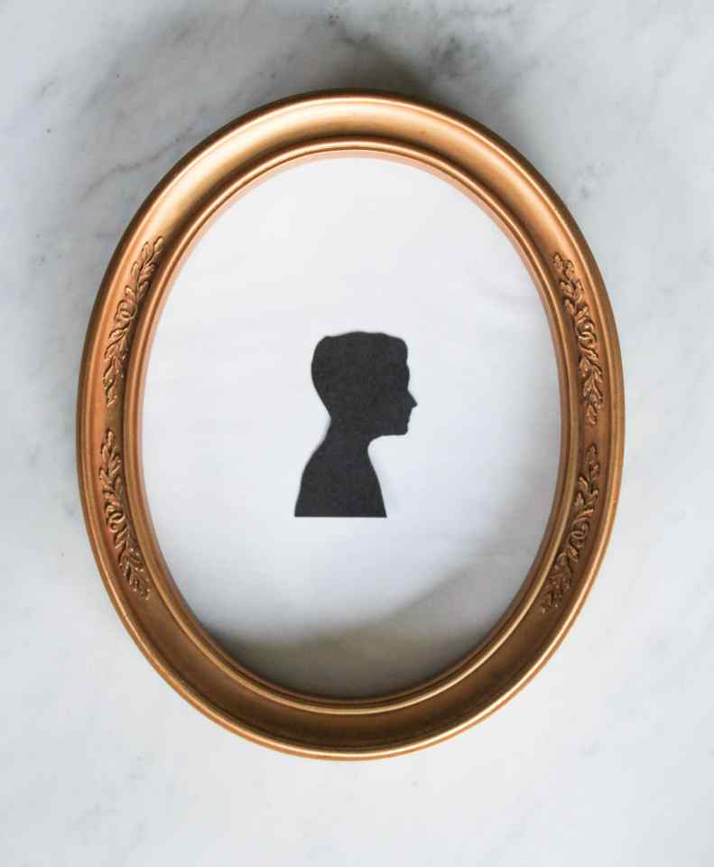 Vintage oval gold frame with diy silhouette picture.