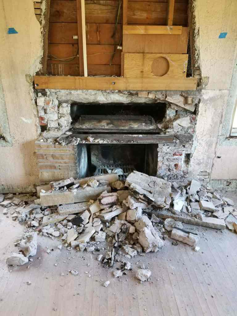 Demolition of fireplace.