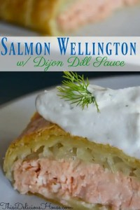 Salmon Wellington with caramelized onions wrapped in puff pastry and served with dijon dill cream sauce
