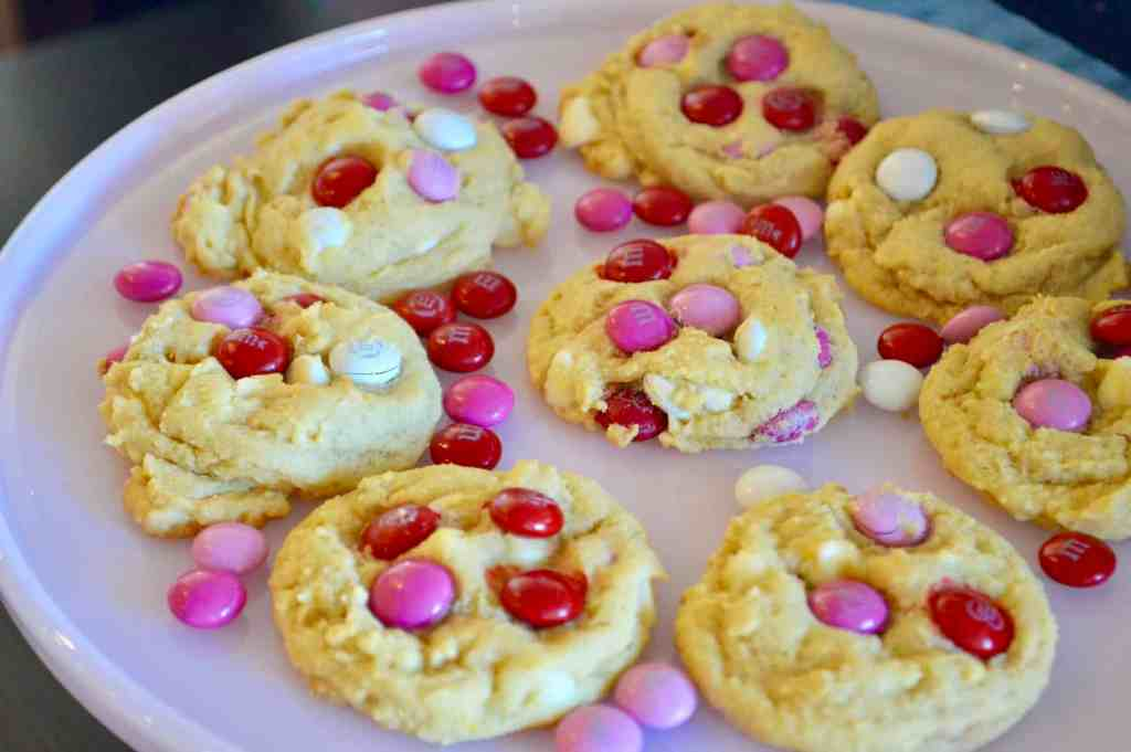 Valentine's Day M&M cookies on a pink cake stand