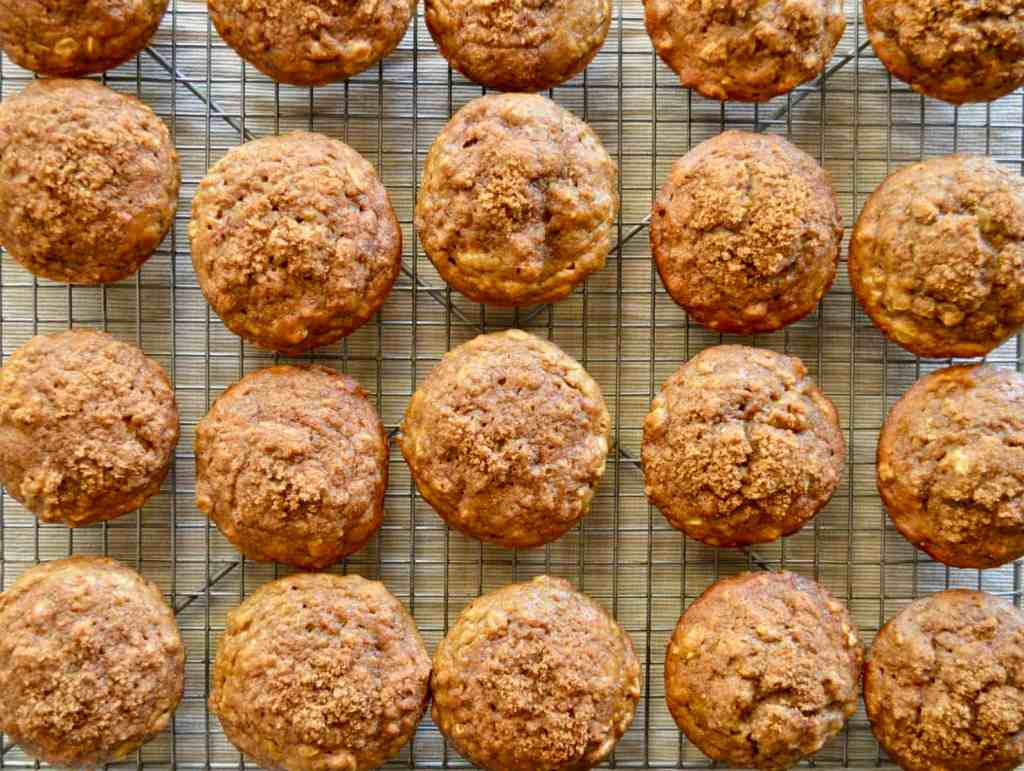 whole wheat banana muffins on a wire rack