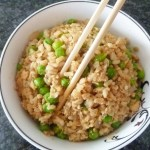"""Skinny Salmon """"Fried"""" Rice -- a complete meal that can be ready in under 30 minutes   thishappymommy.com"""