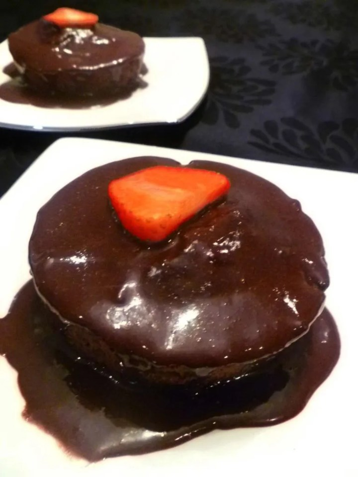 Warm Chocolate Cake for Two -- A perfect Valentine's Day cake. It's warm, chocolatey, and covered with a honey-sweetened chocolate glaze. | thishappymommy.com