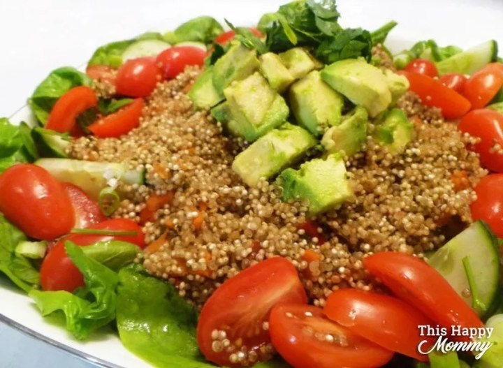 WARM AVOCADO QUINOA SALAD -- My family loves this salad! It's perfect for lunch or dinner. If you love big, tasty salads,Warm Avocado Quinoa Salad is all that and more. With warm quinoa served on a bed of spinach, avocado, cucumber, cherry tomatoes,and covered with a light lemon dressing, this salad is sure to please. healthy and easy family meals | meatless monday | low carb vegetarian meals | Healthy Clean Eating Salad Recipes | Quinoa Salad Recipes | Healthy Salad Bowl Dinners | #salad #recipe #healthyrecipe #meatlessmonday #dinner | thishappymommy.com
