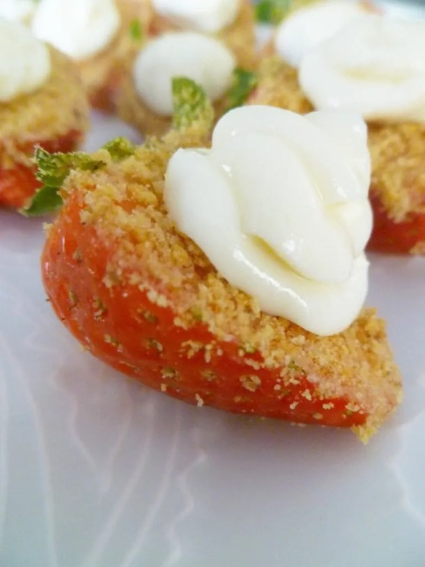 Strawberry Cheesecake Bites - Strawberry bites covered with a graham cracker crust and a swirl of creamy cheesecake. | thishappymommy.com
