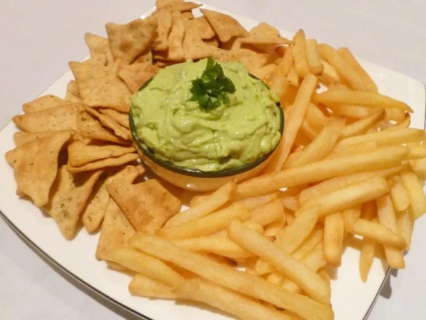 Avocado Cream Sauce -- Rich and creamy avocado sauce perfect for tortilla chips, salmon, chicken, steak, or french fries. | thishappymommy.com