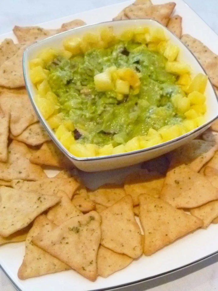 Pineapple Guacamole -- Give your guacamole a boost of tropical fresh flavour. With avocados, pineapple, red onions, lime juice and cilantro, this sweet and savoury guacamole is a real crowd pleaser. | thishappymommy.com