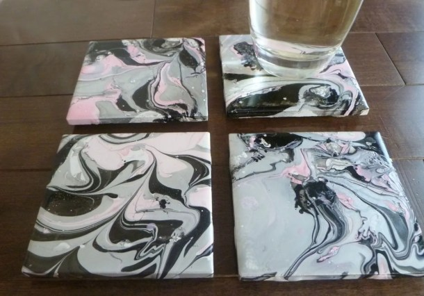DIY Swirl Painted Coasters -- With a swirl painted design, DIY coasters are decorated with nail polish. | thishappymommy.com