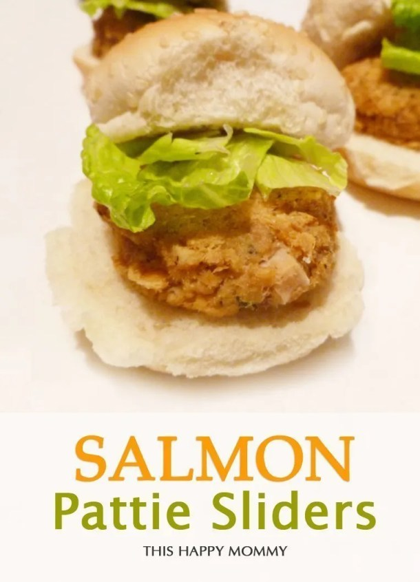 Salmon Pattie Sliders -- Made with canned salmon, this simple recipe can be thrown together in 15 minutes. Serve them with your favourite burger fixings for a tasty, family-friendly meal. #easyrecipe #dinner #appetizer | thishappymommy.com
