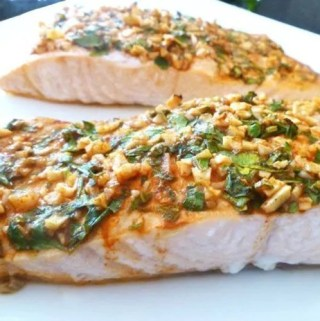 Serve up a quick and easy salmon dinner that is full of flavour! Lemon Herb Crusted Salmon is covered with lemon, garlic, and fresh parsley. This is one tasty baked fish dish.