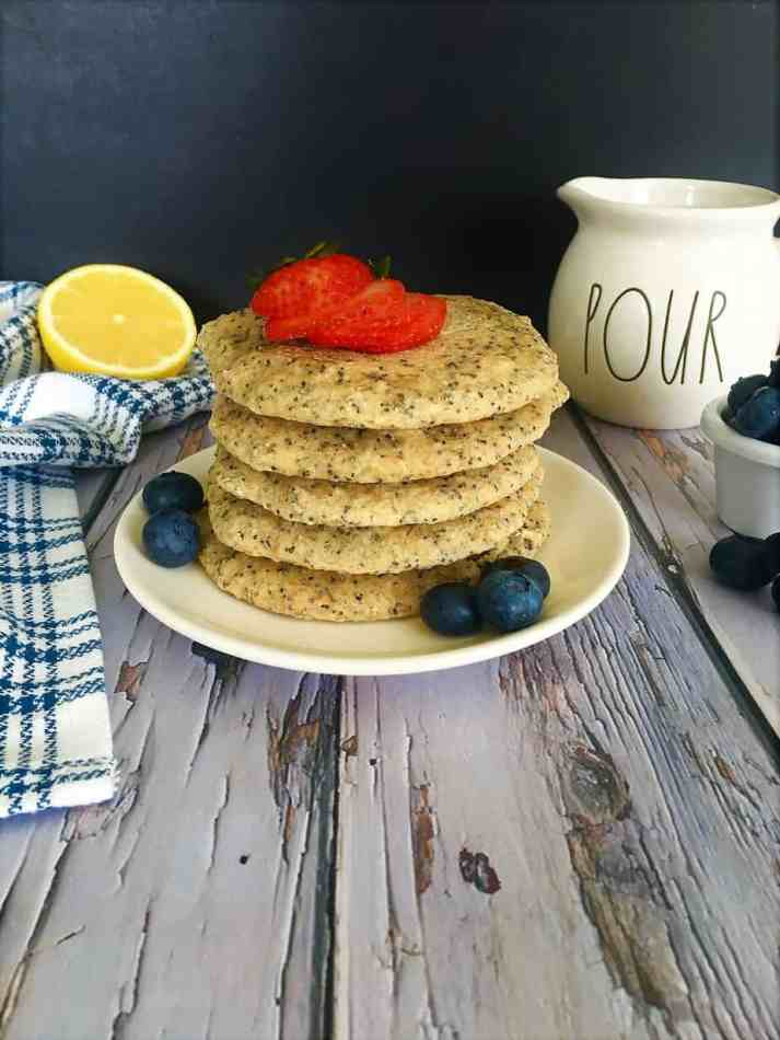 lemon poppy seed pancakes with strawberries and blueberries on top