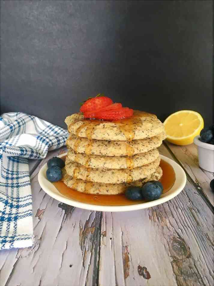 stack of lemon poppy seed pancakes with maple syrup