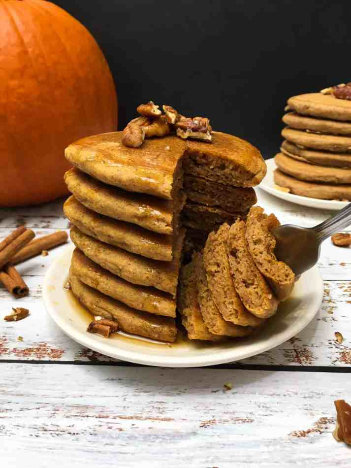 fork cutting through stack of pumpkin spice pancakes