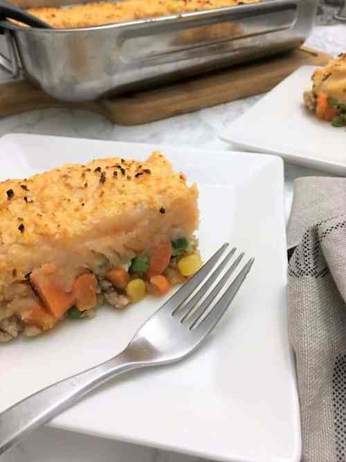 Chicken Shepherd's Pie sliced on plate with fork