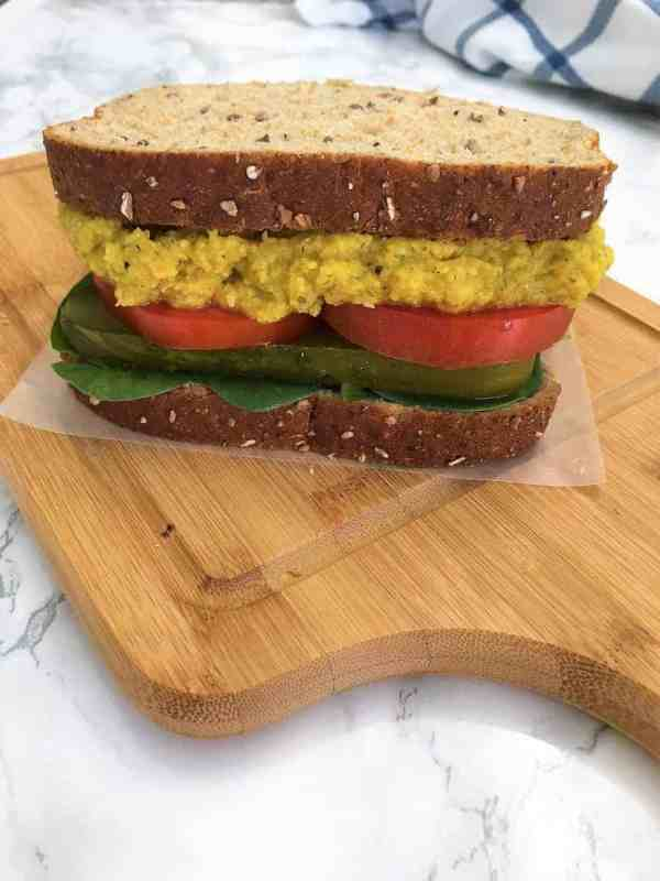 Chickpea Salad Sandwich with tomato, pickle, and baby spinach