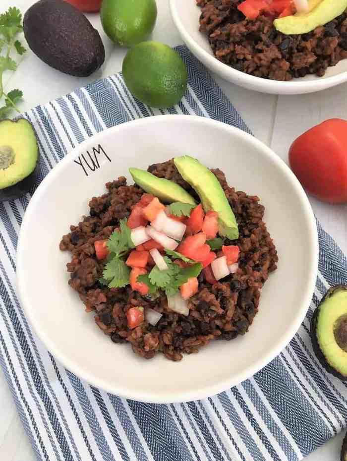 Instant Pot Mexican Casserole with tomato, cilantro, white onion, avocado on top