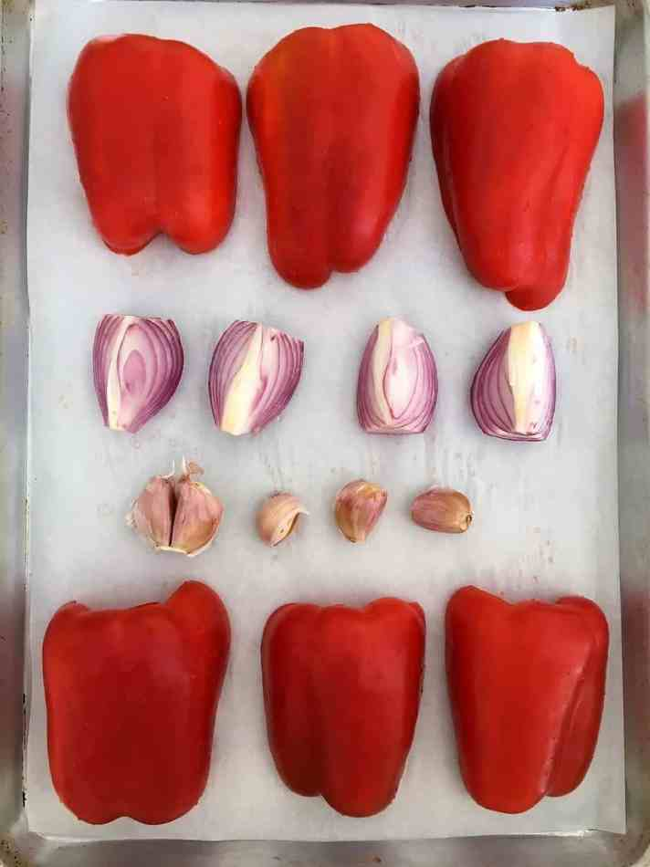 peppers, garlic and onion on baking sheet