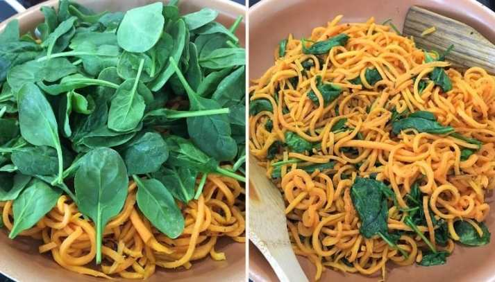 sweet potato noodles and spinach cooking in skillet
