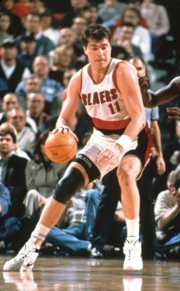 European Player Lithuanian Arvydas Sabonis on the court in action dribbling ball in his right hand