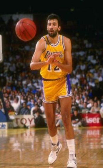 European Player Serbian Vlade Divac on the court in action with the ball in mid-pass