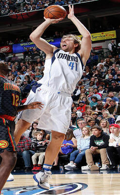 Photo of Dirk Nowitzki in action on the court, jumping about to shoot the ball