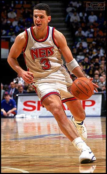 Croatian Drazen Petrovic on the court running dribbling ball on his left hand