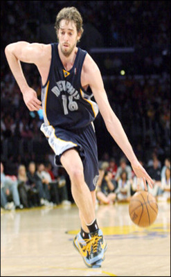 Photo of Pau Gasol in action on the court, running while dribbling ball on left hand